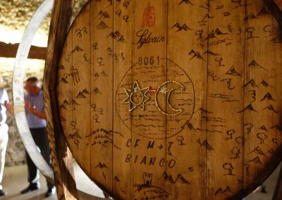 On the back, the woodburning map of the Friulian countryside is taken from the label of the winery.
