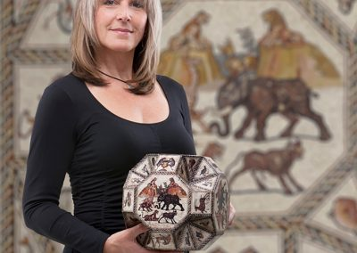 Lillian Sizemore holds the stellated great rhombicuboctahedron shape made from analyzing the mosaic's geometry.