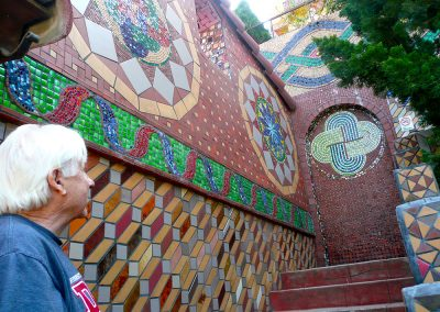 George looks up the stairway to his Mediterannean-style home, entirely decorated in mosaic, tile and glass, expressing his lifelong passion for materials and pattern.