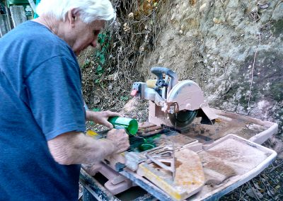 Ehling cuts on his wet saw from scavenged scrap tile, but he cut thousands of square feet by hand with a tile stripper!