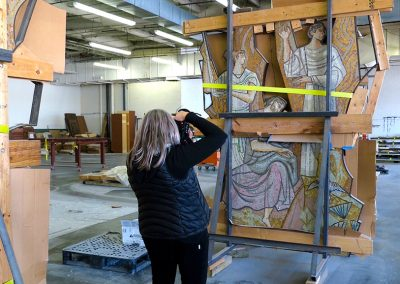 Lillian Sizemore photographing 1958 mosaic panels from the Mercantile Bank during storage and conservation in Dallas, TX.