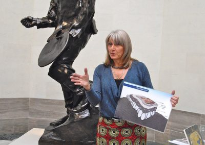 Lillian describes the underlayment of ancient mosaics at the Legion of Honor Museum, San Francisco, as a Rodin sculpture watches on.