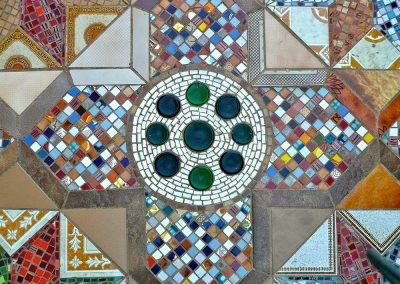 Guest House courtyard pavement, tile and glass, expressing his lifelong passion for materials and pattern.
